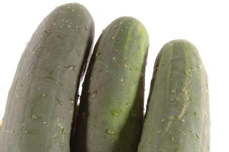 cucumbers: three cucumbers  diminishing on white Stock Photo