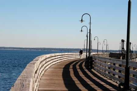 walking the pier with shadows photo