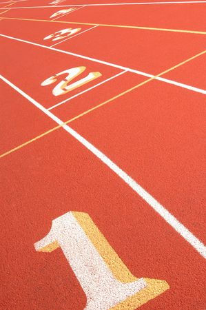 1234 on a running track focus fading from one to four