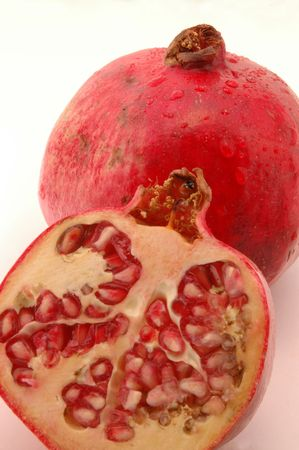 tangy:  pomegranates with one cut open