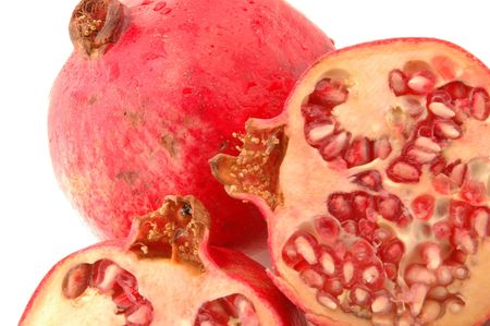 fresh healthy pomegranates with one cut open