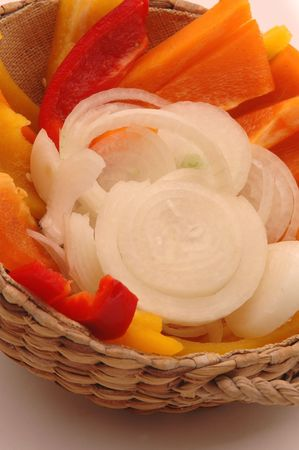 close up of onions in a basket: onions and peppers 92