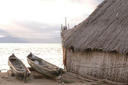 kuna indian hut with cayucas sunrise panama 1054 photo