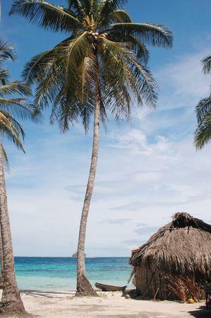 placid: native hut with cayuco boat placid beach panama 1024 Stock Photo