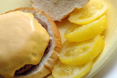 cheeseburger with yellow tomatoes photo