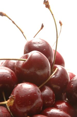bing: cherries on white focus on the big one in the center Stock Photo