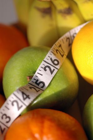 fruit diet with focus on tape measure with macro lens photo