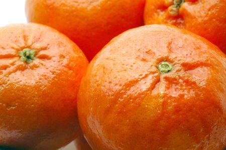 luscious: luscious tangerines macro focus on stem Stock Photo
