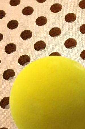platform tennis paddle and sponge ball detail