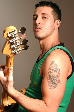 bass player with tattoo and attitude photo