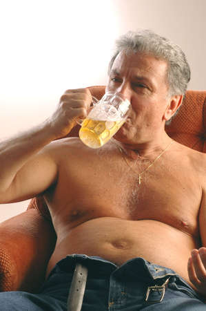 beer belly model released with dramatic fading white background photo