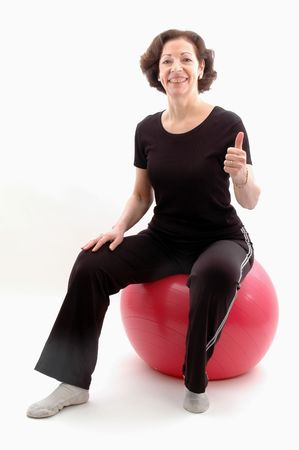 smiling woman on fitness ball  thumbs up 951