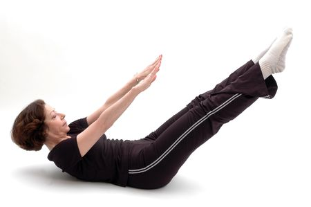 woman in yoga position 960 Stock Photo