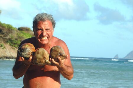 crazy man with coconuts 519 photo