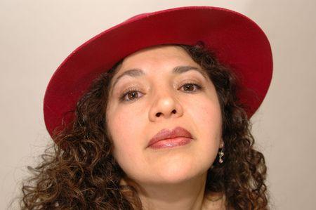 intense hispanic woman red hat 1054 Stock Photo - 337176