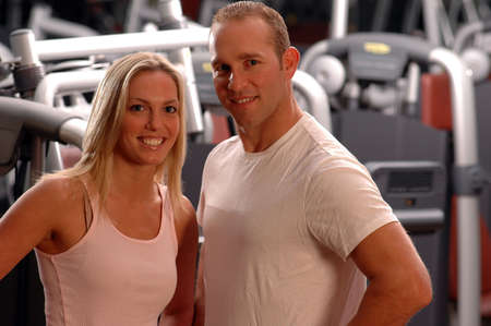 happy fitness couple in the gym photo