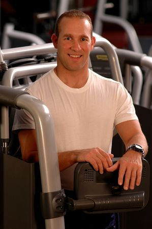 physique: handsome man in fitness center