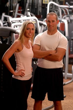 couple at the fitness club focus on the woman Stock Photo