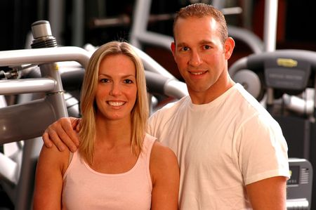good looking couple in fitness center gym photo