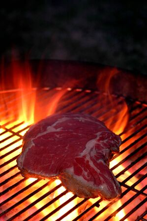 hot charcoal barbecue  with steak photo