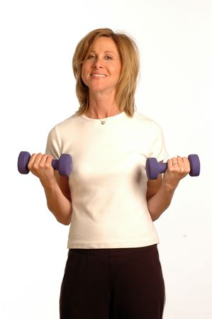 pretty fitness instructor with dumbbells photo