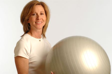 fit woman with smile using core training ball photo