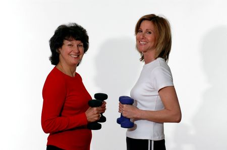 women using free weight dumbbells middle age Stock Photo