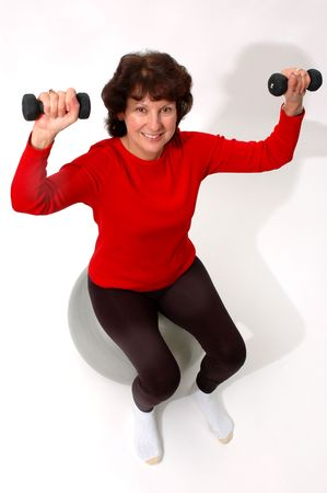 attractive middle aged woman exercising photo