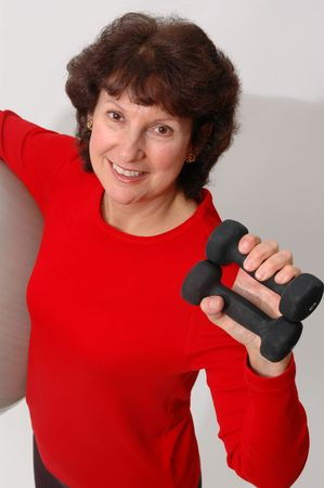 woman with dumbbells and fitness ball photo