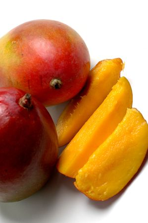 juicy ripe mangoes and slices Stock Photo