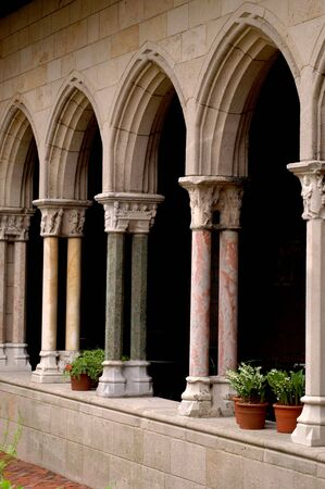 cloisters with potted plants and garden Stock Photo