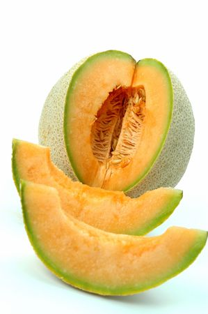 athena: athena melon and slices focus on melon Stock Photo