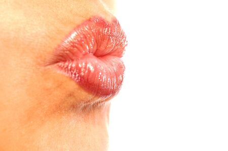 kissing lips: woman kissing lips Stock Photo