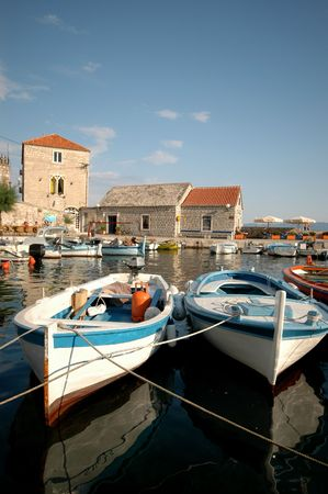 boats in the harbor fishing village photo