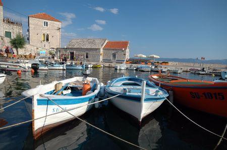 fishing village: boats in the harbor fishing village horizontal