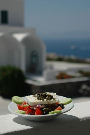 greek salad in taverna with scenic view photo