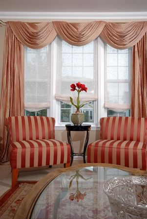 curtain window:  living room chairs and coffee table with bowl