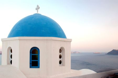 house of worship: greek church dome at sunrise over the sea