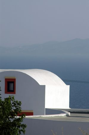 typical: typical greek building over sea in santorini island Stock Photo
