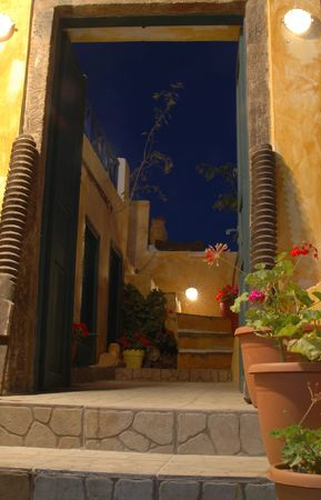 steps leading to restaurant in greek islands at night photo