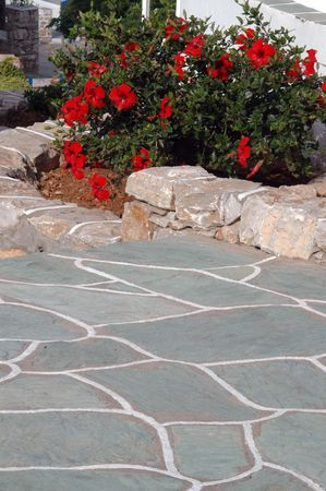 whitewash: typical stone walkway and walls with flowers greek islands