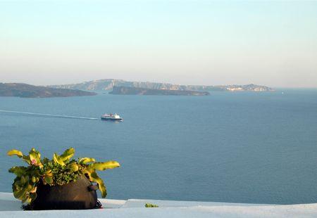scenic overlook in oia santorini greece islands with cruise ship photo