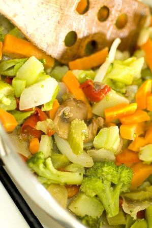 broccoli stir fry with carrots onions red peppers and other vegetables shallow depth of field focus