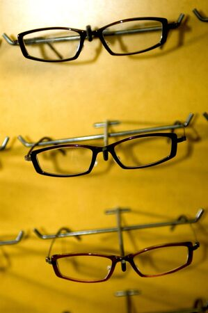 display of eyeglass frames on a store wall photo