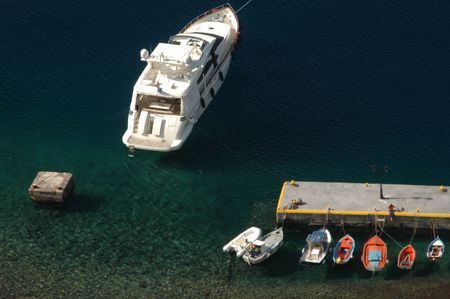 yacht and small boats in harbor greek islands photo