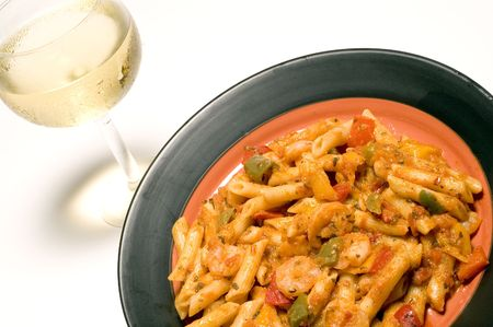 spicy shrimp fra diavolo and penne pasta with white wine photo