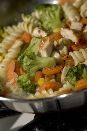 garlic chicken pasta sauce grilled broccoli corn carrots dinner photo