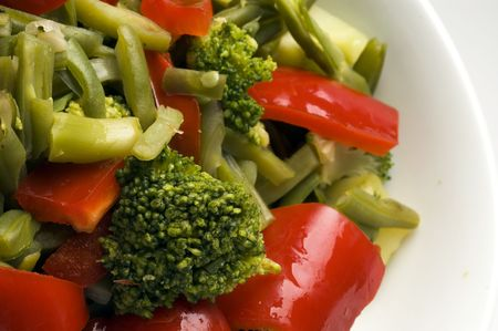 broccoli beans onions peppers in white bowl photo