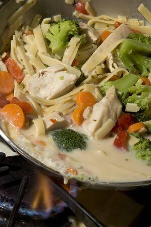 primavera: cooking pasta primavera with chicken and sauce