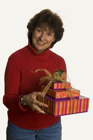 happy woman with gift smiling middle age photo